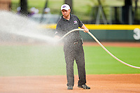 Winston-Salem Dash head grounds keeper Doug Tanis waters down the infield prior to the game against the Salem Red Sox at BB&T Ballpark on May 5, 2012 in Winston-Salem, North Carolina.  (Brian Westerholt/Four Seam Images)