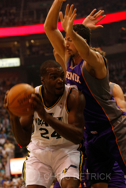 Chris Detrick  |  The Salt Lake Tribune .Utah Jazz power forward Paul Millsap #24 is guarded by Phoenix Suns small forward Hedo Turkoglu #19 during the first half of the game Thursday October 28, 2010.  Phoenix is winning the game 58-42.