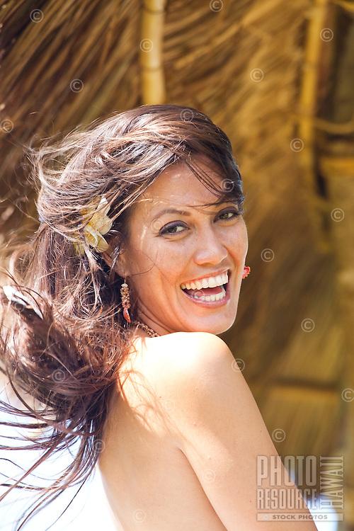 Young Hawaiian woman enjoying a sunny day in a beachfront gazebo