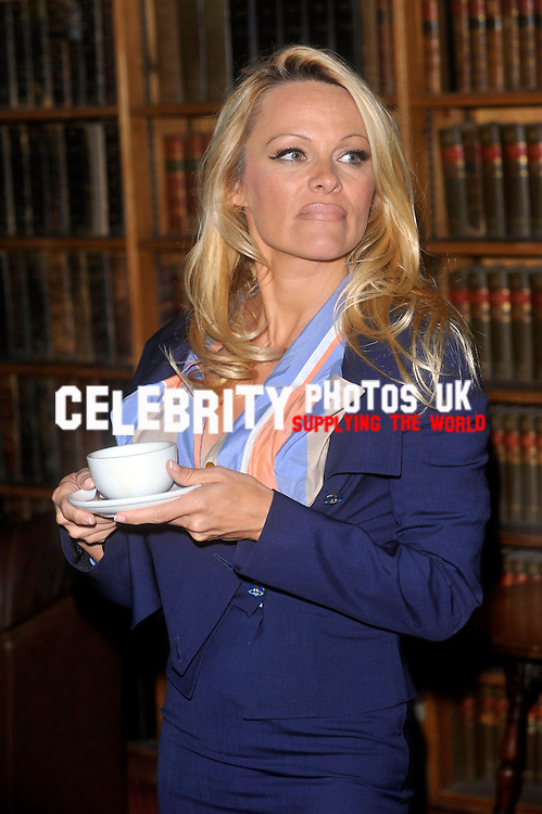 pamela anderson is joined by PETA's Senior Vice President Dan Mathews at the oxford union to give a talk on vegetarian diets and to introduce a screening of Paul McCartney's campaign video Glass Walls. She fields questions on the use of sex and celebrities in the organisation's ads
