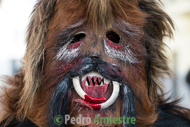 "A Carantoña poses during the Carantoñas festival, in Acehúche near Cáceres, on January 21, 2015. The ""Carantoñas"", monster-animal characters mixing paganism with Christianity, search for Saint Sebastian in the streets of the village of Acehúche, southwestern Estremadure province, dressed in patchwork sheep, cow, rabbit and goatskins under painted masks. Arriving eventually at the village church, a procession takes place with the statue of the patron saint. Until recently, Spain's neighbors, the Berbers of Morocco, preserved a version of the same ritual in their animal-hided winter ""goblin,"" Bou Inania.  © Pedro ARMESTRE"