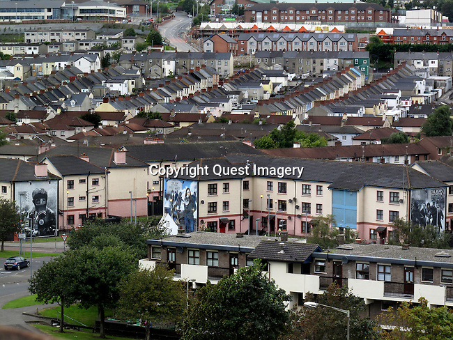A mural depicting Josephine Bernadette Devlin, in center,  displayed on the side of an apartment complex called the Rossville Flats  in the Bogside, a neighborhood outside the city walls of Derry, Northern Ireland.<br />