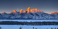 A setting moon at sunrise in Grand Teton National Park