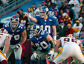 Landover, MD - December 24, 2005 -- New York Giants quarterback Eli Manning (10) directs the offense as his offensive linemen Chris Snee (76) and Shaun O'Hara (60) exchange line signals against the Washington Redskins at FedEx Field in Landover, MD on December 24, 2005.  The Redskins won the game 35 - 20..Credit: Ron Sachs / CNP.(RESTRICTION: NO New York or New Jersey Newspapers or newspapers within a 75 mile radius of New York City)