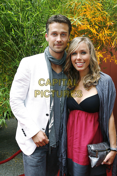 WAYNE CARPENDALE & ANNEMARIE WARNKROSS.Bavaria Film Reception for Munich Film Festival 2009, Artist House at Lenbachplatz, Munich, Germany..June 30th, 2009.half length white suit jacket scarf pink black top couple .CAP/PPG/TF.©T. Furthmayr/People Picture/Capital Pictures