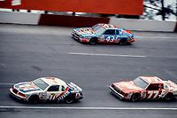 HAMPTON, GA - NOV 3:  Kyle Petty, #7 Ford, Richard Petty, #43 Pontiac and Greg Sacks, #77 Buick, race through a turn during the Atlanta Journal 500 NASCAR Winston Cup race at Atlanta Motor Speedway, November 3, 1985. (Photo by Brian Cleary/www.bcpix.com)
