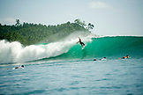 INDONESIA, Mentawai Islands, Kandui Resort, surfer on a wave, Beng Beng