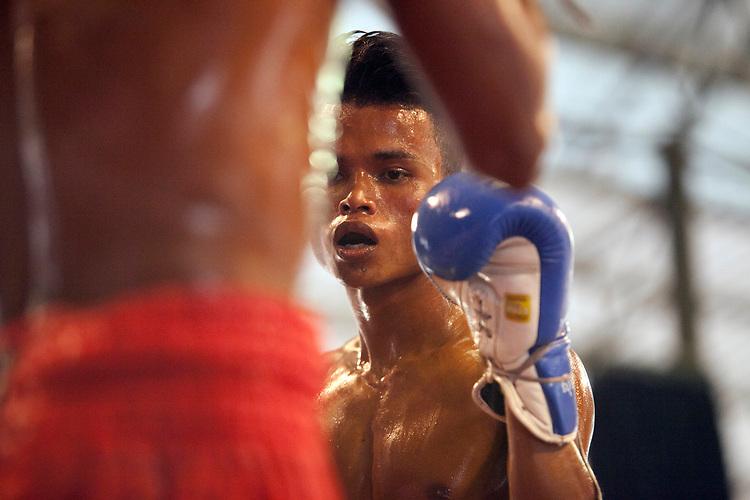 Kick boxing in Phnom Penh, Cambodia. <br /> <br /> Photos &copy; Dennis Drenner 2013.