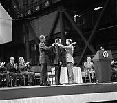 Cape Canaveral, FL - (FILE) -- Astronaut Neil A. Armstrong receives the first Congressional Space Medal of Honor from United States President Jimmy Carter, assisted by Captain Robert Peterson on October 1, 1978. Armstrong, one of six astronauts to be presented the medal during ceremonies held in the Vehicle Assembly Building (VAB), was awarded for his performance during the Gemini 8 mission and the Apollo 11 mission when he became the first human to set foot upon the Moon..Credit: NASA via CNP