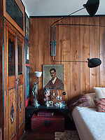 The wardrobe in the master bedroom is embellished with inlaid decoration and glazed panels, one of the few ornamental details in this relatively simple room