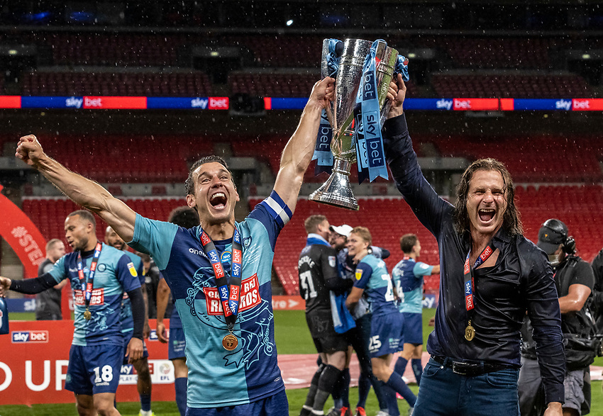 Wycombe Wanderers' Matthew Bloomfield (left) celebrates with manager Gareth Ainsworth <br /> <br /> Photographer Andrew Kearns/CameraSport<br /> <br /> Sky Bet League One Play Off Final - Oxford United v Wycombe Wanderers - Monday July 13th 2020 - Wembley Stadium - London<br /> <br /> World Copyright © 2020 CameraSport. All rights reserved. 43 Linden Ave. Countesthorpe. Leicester. England. LE8 5PG - Tel: +44 (0) 116 277 4147 - admin@camerasport.com - www.camerasport.com