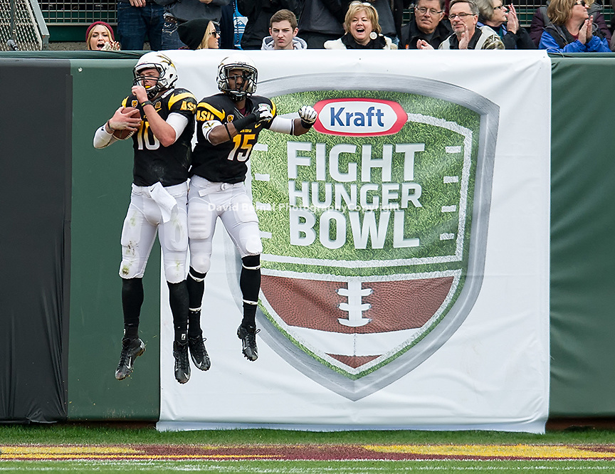 SAN FRANCISCO, CA - December 29, 2012: Arizona State quarterback Taylor Kelly (10) and X-back Rashad Ross (15) celebrate a touchdown during the Navy Midshipmen vs the Arizona State Sun Devils in the 2012 Kraft Fight Hunger Bowl at AT&T Park in San Francisco, California. Final score Navy 28, Arizona State 62.