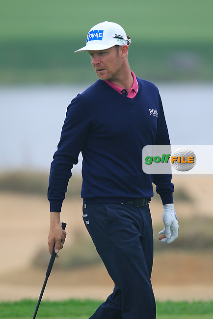 Mikko Ilonen (FIN) on the 4th green during Saturay's Round 3 of the 2014 BMW Masters held at Lake Malaren, Shanghai, China. 1st November 2014.<br /> Picture: Eoin Clarke www.golffile.ie
