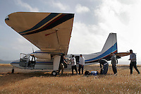 SANTA ROSA ISLAND,CA - May 05, 2008: One of the ways to arrive at Santa Rosa Island is on a small airplane. Fisherman unload their supplies off a Channel Islands aviation plane, May 5, 2008.