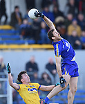 Gary Brennan of Clare in action against Tadgh O Rourke of Roscommon during their National League game at Cusack Park. Photograph by John Kelly.