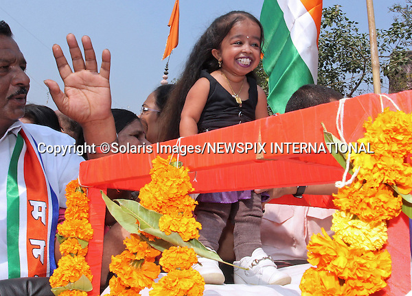 """Mumbai,India-31/01/2012: JYOTI AMGE ON INDIAN ELECTIONS CAMPAIGN.They say that anything goes in politics..So it was no surprise that the Maharashtra Navnirman Sena paraded Jyoti Amge, the world's shortest woman during their campaign for  the forth coming civic election in Mumbai, India.Mandatory Photo Credit: ©Ramesh Nair-Solaris Images/NEWSPIX INTERNATIONAL..**ALL FEES PAYABLE TO: """"NEWSPIX INTERNATIONAL""""**..PHOTO CREDIT MANDATORY!!: NEWSPIX INTERNATIONAL(Failure to credit will incur a surcharge of 100% of reproduction fees)..IMMEDIATE CONFIRMATION OF USAGE REQUIRED:.Newspix International, 31 Chinnery Hill, Bishop's Stortford, ENGLAND CM23 3PS.Tel:+441279 324672  ; Fax: +441279656877.Mobile:  0777568 1153.e-mail: info@newspixinternational.co.uk"""
