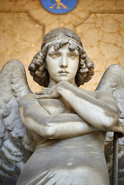 Picture and image of the stone sculpture of an enigmatic angels face in a realistic style. One of the best know csulptures of Staglieno. The Oneto family tomb sculpted by G Monteverde. Section D no 13, the monumental tombs of the Staglieno Monumental Cemetery, Genoa, Italy