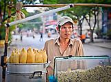 VIETNAM, Ho Chi Minh, Saigon, a street food vendor selling corns on a cob