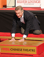 PAP0213JP400.Robert De Niro has left his marks in Hollywood. The 69-year-old movie veteran had his handprints and footprints cemented in a ceremony taking place Monday, January 4 at the famed TCL Chinese Theatre, which was formerly known as Grauman's Chinese Theatre. He placed his hands and feet in concrete near those of Marilyn Monroe, Elizabeth Taylor, Brad Pitt and George Clooney. ... /NortePhoto