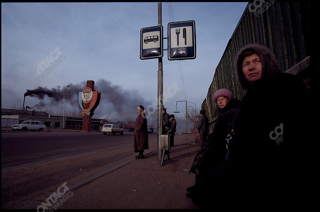Black smoke from a factory clouds the sky. Samarqand, Uzbekistan. February 1992