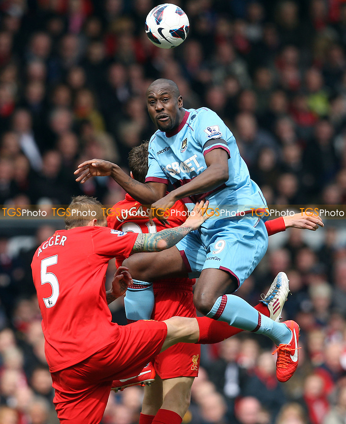 Carlton Cole of West Ham gets above Daniel Agger and Lucas of Liverpool - Liverpool vs West Ham United, Barclays Premier League at Anfield, Liverpool 07/04/13 - MANDATORY CREDIT: Rob Newell/TGSPHOTO - Self billing applies where appropriate - 0845 094 6026 - contact@tgsphoto.co.uk - NO UNPAID USE.