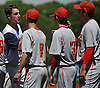 Reiss Knehr of St. Dominic High School, left, congratulates Chaminade players after they won the NSCHSAA varsity baseball championship at New York Institute of Technology on Monday, May 25, 2015.<br /> <br /> James Escher