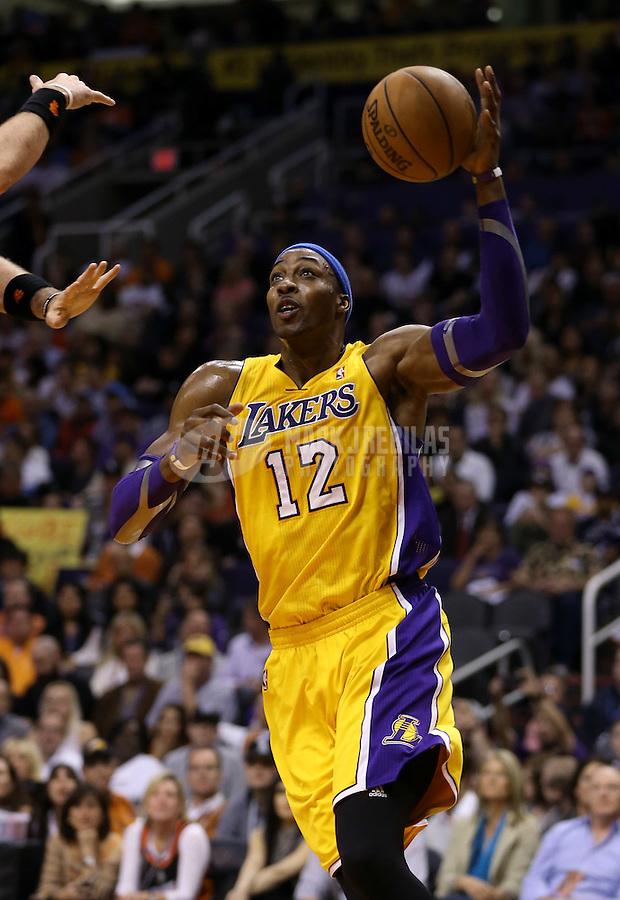 Jan. 30, 2013; Phoenix, AZ, USA: Los Angeles Lakers center Dwight Howard (12) against the Phoenix Suns at the US Airways Center. Mandatory Credit: Mark J. Rebilas-