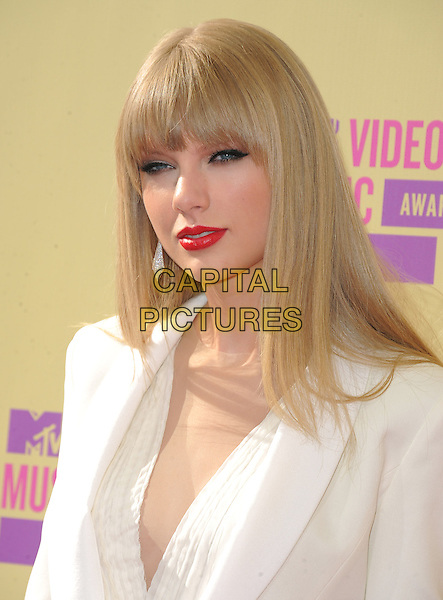 Taylor Swift.Arrivals at The 2012 MTV Video Music Awards held at Staples Center in Los Angeles, California, USA..September 6th, 2012.VMA's VMAS VMA headshot portrait red lipstick white suit blazer jacket fringe  .CAP/DVS.©DVS/Capital Pictures.
