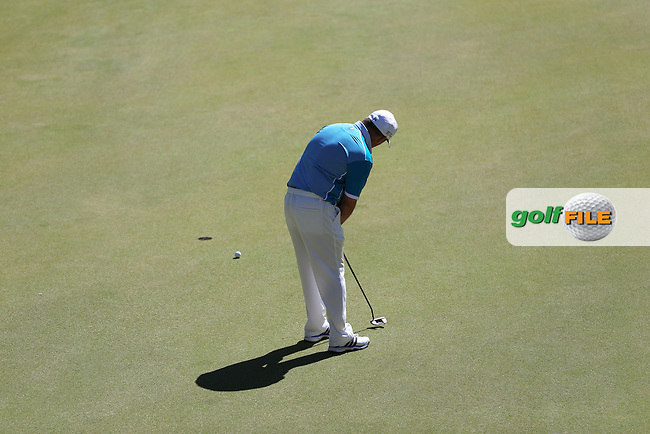 Damien McGrane (IRL) holes out on the 9th during Round Three of the Africa Open 2015 at the East London Golf Club, East London, Eastern Cape, South Africa. Picture:  David Lloyd / www.golffile.ie. 07/03/2015