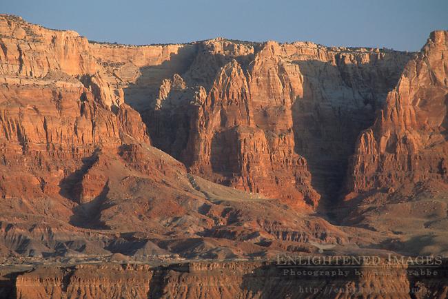 Sunrise light on red sandstone cliffs near Navajo Bridge, Vermilion Cliffs National Monument, near Page, Arizona