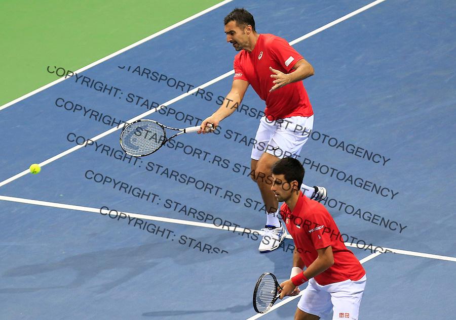 Davis Cup 2014 first round<br /> Srbija v Hrvatska<br /> Novak Djokovic and Nenad Zimonjic-Serbia v Franko Skugor and Marin Draganja doubles dublovi<br /> Nenad Zimonjic (L) and Novak Djokovic<br /> Kraljevo, 07.03.2015.<br /> Foto: Srdjan Stevanovic/Starsportphoto.com&copy;