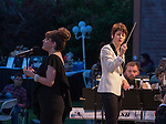 Maestro Laura Jackson and Alli Mauzey perform with the Reno Phil during the Pops on the River fundraiser at Wingfield Park in Reno on  Saturday, July 9, 2016.