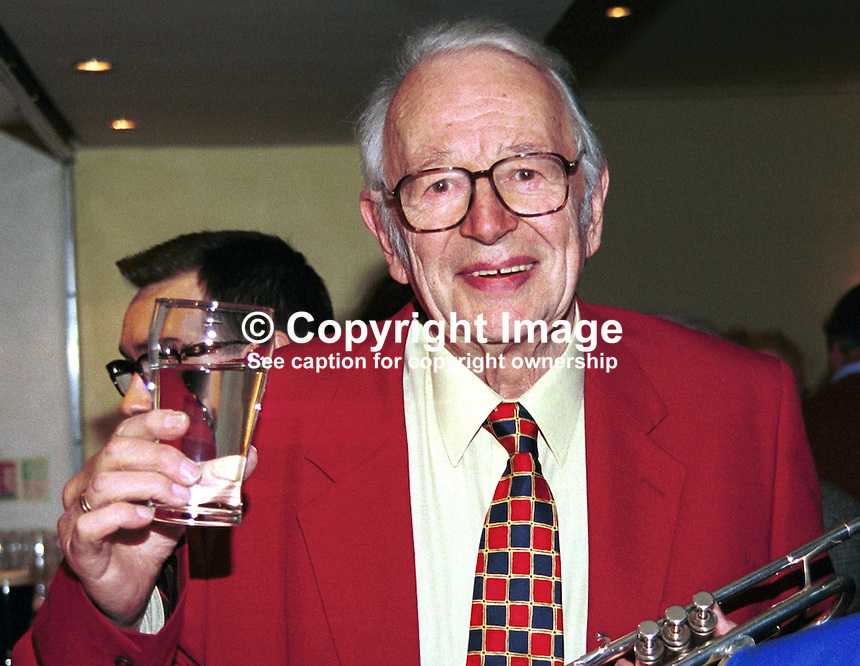 British jazz personality Humphrey Lyttelton in jocular mood at the bar of the Culloden Hotel during the 1999 Holywood International Jazz Festival, Holywood, Co Down, N. Ireland. Ref: 199906003..Copyright Image from Victor Patterson, 54 Dorchester Park, Belfast, UK, BT9 6RJ..Tel: +44 28 9066 1296.Mob: +44 7802 353836.Voicemail +44 20 8816 7153.Skype: victorpattersonbelfast.Email: victorpatterson@mac.com.Email: victorpatterson@ireland.com (back-up)..IMPORTANT: If you wish to use this image or any other of my images please go to www.victorpatterson.com and click on the Terms & Conditions. Then contact me by email or phone with the reference number(s) of the image(s) concerned.