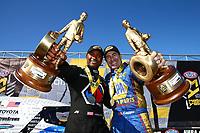 May 21, 2017; Topeka, KS, USA; NHRA top fuel driver Antron Brown (left) and funny car driver Ron Capps celebrate after winning the Heartland Nationals at Heartland Park Topeka. Mandatory Credit: Mark J. Rebilas-USA TODAY Sports