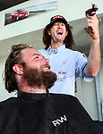"Daniel McNicholl has his mullet chopped by Holden Ambassador Greg Murphy. Holden New Zealand, ""Mullet Amnesty Day"", trade your mullet for a Holden Astra, West City Holden, Auckland, New Zealand, Saturday 1st April 2017. Photo: Simon Watts/www.bwmedia.co.nz"