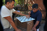 (171006RREI4462) La Esquina where Latinos have gathered for decades at the corner of Mt. Pleasant St. and Kenyon St. NW. to play chekers (damas). El Rana on the right.  Washington DC Oct. 6 ,2017 . ©  Rick Reinhard  2017     email   rick@rickreinhard.com