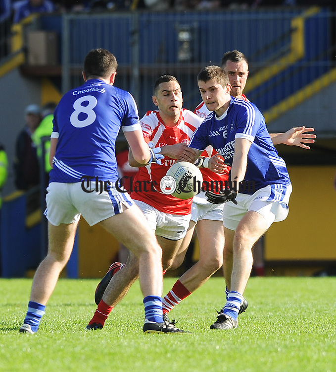 Cillian Duggan and Micheal Hawes of Cratloe in action against Dean Ryan of Eire Og during their senior football final at Cusack park. Photograph by John Kelly.