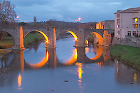 Carcassonne. Languedoc. The old bridge across the Aude river. Illuminated in early morning. A rainy and misty winter day. France. Europe.