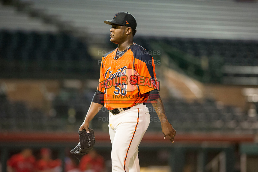 AZL Giants relief pitcher Weilly Yan (58) walks to the dugout between innings during a game against the AZL Angels on July 10, 2017 at Scottsdale Stadium in Scottsdale, Arizona. AZL Giants defeated the AZL Angels 3-2. (Zachary Lucy/Four Seam Images)