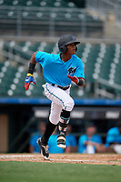 Miami Marlins Yoelvis Sanchez (87) runs to first base during an Instructional League game against the Washington Nationals on September 25, 2019 at Roger Dean Chevrolet Stadium in Jupiter, Florida.  (Mike Janes/Four Seam Images)