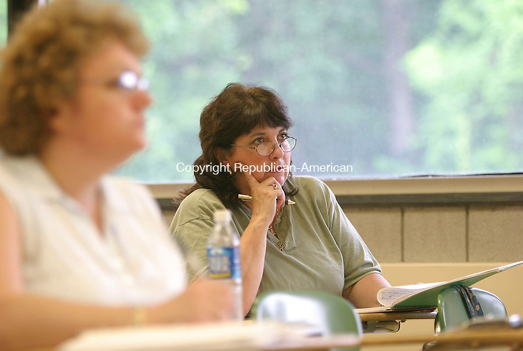 WATERBURY, CT 19 July 2005 -071905BZ13- Students, including Terry Ingram, of Thomaston, right, take notes and listen to the instructor during a legal assistant/paralegal class at Naugatuck Valley Community College in Waterbury Monday. <br /> Jamison C. Bazinet Photo