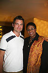 Daniel Cosgrove poses with Brenda Waters - news anchor KDKA-TV - Guiding Light's actors at a private dinner on top of Mount Washington, near Pittsburgh, PA on the night before October 1, 2009 in the Pittsburgh, PA area as the actors GO PINK with Panera Bread as they visit many of the Panera Bread locations the next day. Proceeds from pink ribbon bagel sales will benefit the Young Women's Breast Cancer Awareness Foundation. (Photo by Sue Coflin/Max Photos)