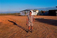 Luc Avolio in Front of Old Farmhouse, Avolio's Farm, Mareeba, 2003.
