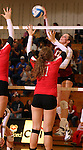 SIOUX FALLS, SD - OCTOBER 25:  Maggie DeJong #17 from Roosevelt tries to get a kill past a pair of defenders including Audrey Bunge #17 from Rapid City Central in the third game of their match Friday night at Roosevelt. (Photo by Dave Eggen/Inertia)