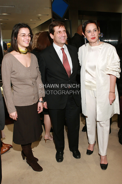 """Guest, Francesco M. Talo, and Rebecca Moses at the Rebecca Moses """"A Life of Style"""" book signing at Fratelli Rossetti Boutique, November 11, 2010."""
