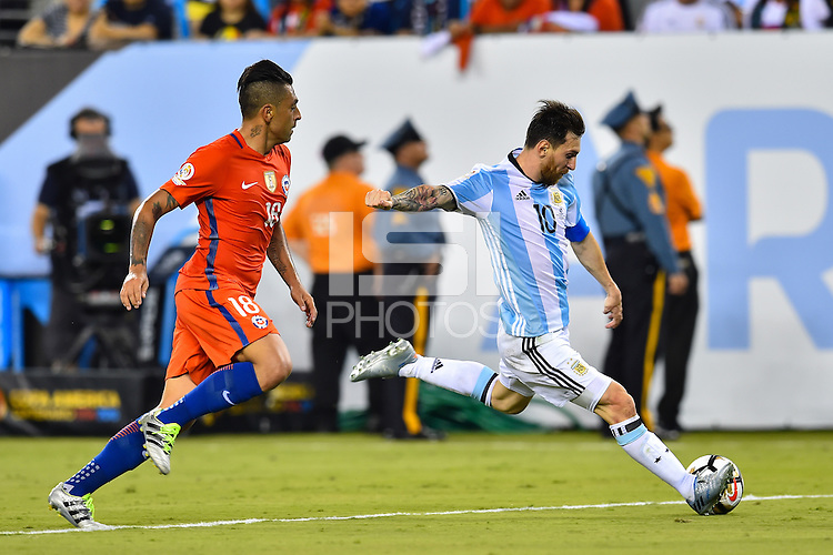 East Rutherford, NJ - Sunday June 26, 2016: Gonzalo Jara, Lionel Messi during a Copa America Centenario finals match between Argentina (ARG) and Chile (CHI) at MetLife Stadium.