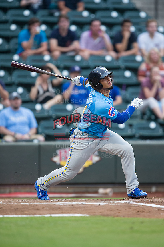 Gleyber Torres (11) of the Myrtle Beach Pelicans follows through on his swing against the Winston-Salem Dash at BB&T Ballpark on July 7, 2016 in Winston-Salem, North Carolina.  The Dash defeated the Pelicans 13-9.  (Brian Westerholt/Four Seam Images)