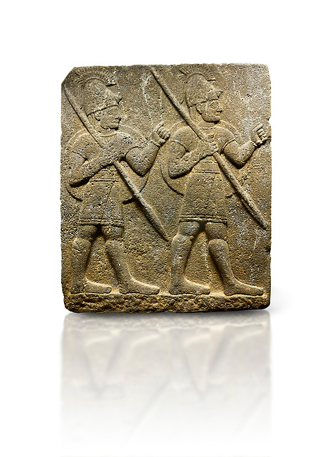 Picture & image of Hittite monumental relief sculpted orthostat stone panel from the Herald's Wall. Basalt, Karkamıs, (Kargamıs), Carchemish (Karkemish), 900-700 B.C. Military parade with soldiers. Anatolian Civilisations Museum, Ankara, Turkey<br /> <br /> Two helmeted soldiers marching soldiers in short skirts carry the shield on their backs and the spears in their hands.  <br /> <br /> Against a white background.