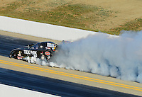 Apr. 13, 2012; Concord, NC, USA: NHRA funny car driver Dale Creasy Jr blows an engine during qualifying for the Four Wide Nationals at zMax Dragway. Mandatory Credit: Mark J. Rebilas-