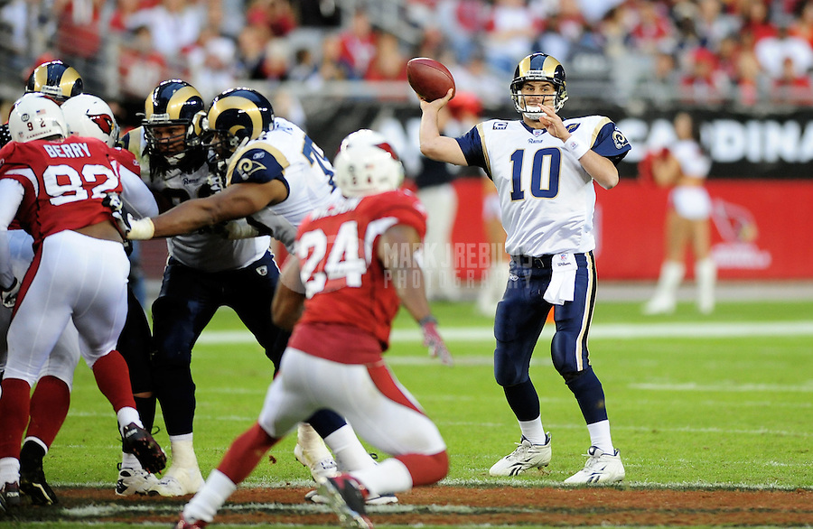 Dec. 7, 2008; Glendale, AZ, USA; St. Louis Rams quarterback Marc Bulger throws a pass in the fourth quarter against the Arizona Cardinals at University of Phoenix Stadium. The Cardinals defeated the Rams 34-10 to clinch the NFC West division title. Mandatory Credit: Mark J. Rebilas-